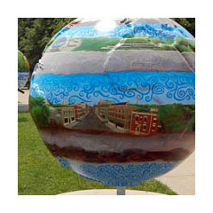 a six-foot globe set in parkland painted with colorful scenes