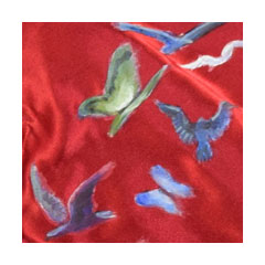 birds and butterflies painted on red satin